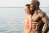 How to get shredded: A muscular man and woman stand beside the ocean