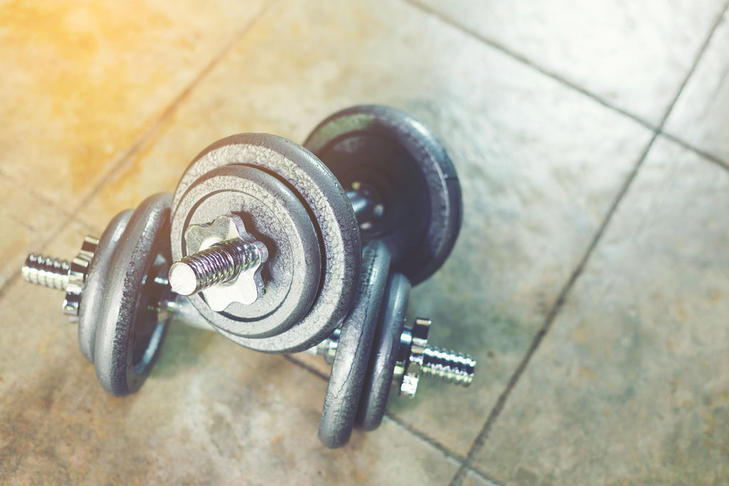 Set of dumbbells sitting on kitchen floor