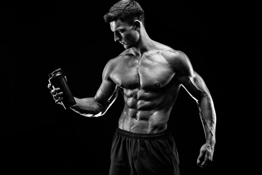 muscular man holding water bottle