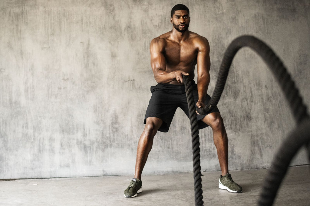 aerobic vs anaerobic: man doing ropes exercise