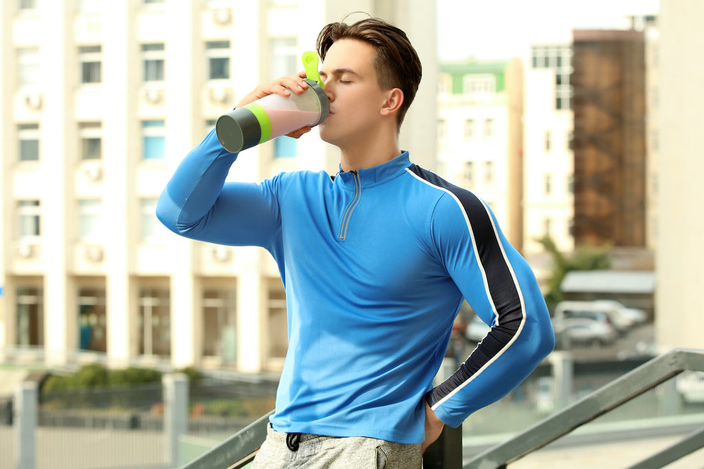 Best mass gainer: An athlete drinks a mass gainer shake