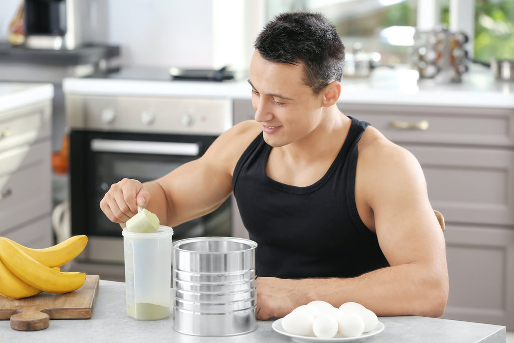 Best mass gainer: A man mixes a mass gainer shake