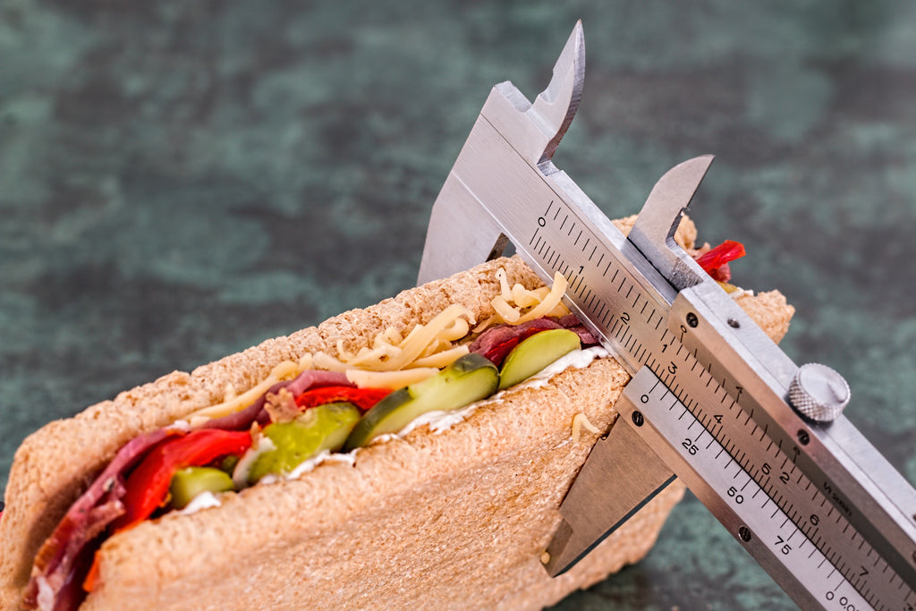 Measuring tool used to measure the width of a healthy sandwich for diet restrictions