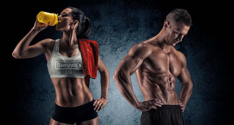 man and woman posing drinking supplement