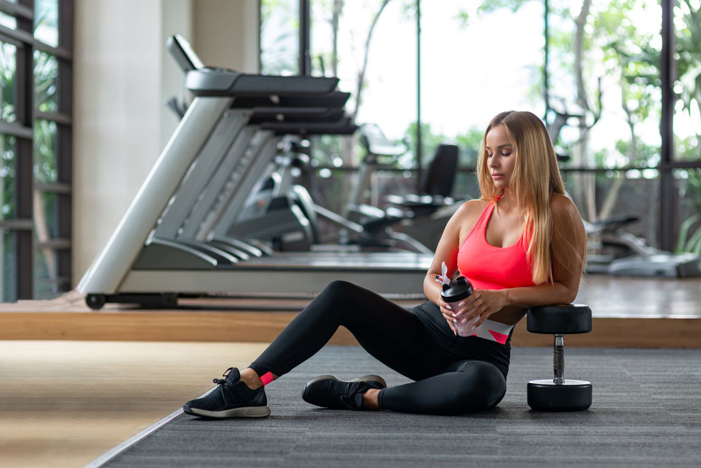 Female athlete relaxing after workout