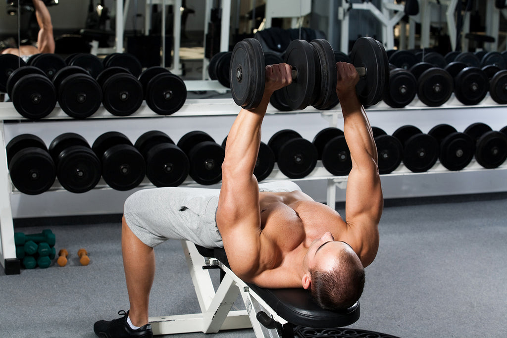 free weight exercises: Man lifting at the gym