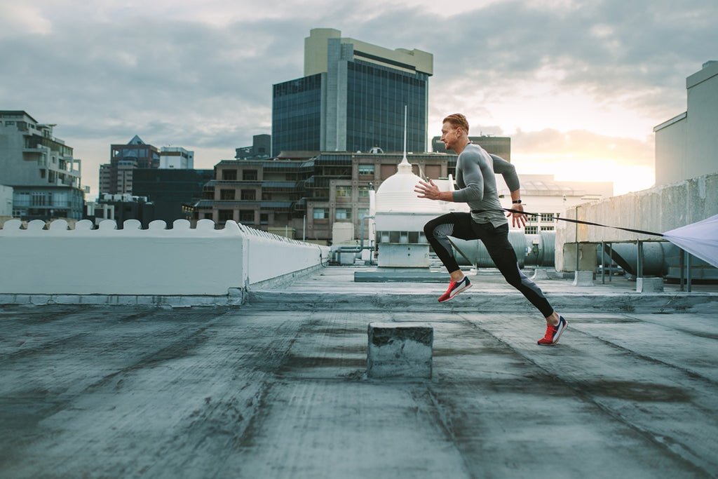 how to run faster: man running on rooftop