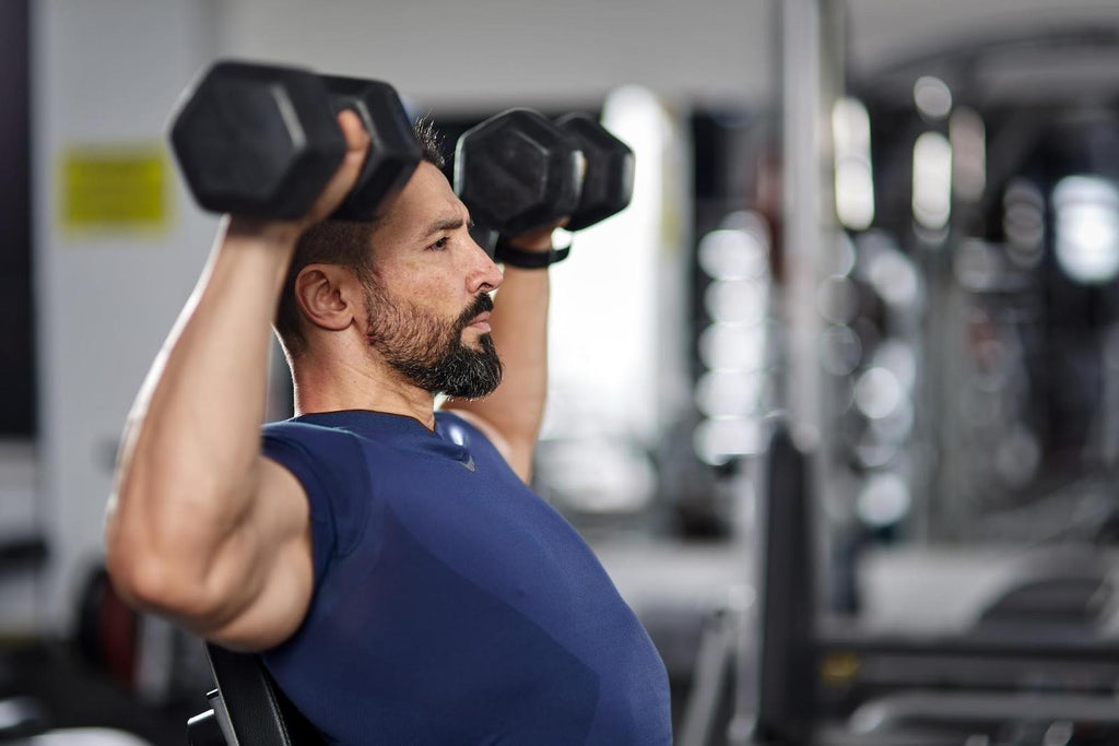 Deltoid workouts: Man lifting dumbbells
