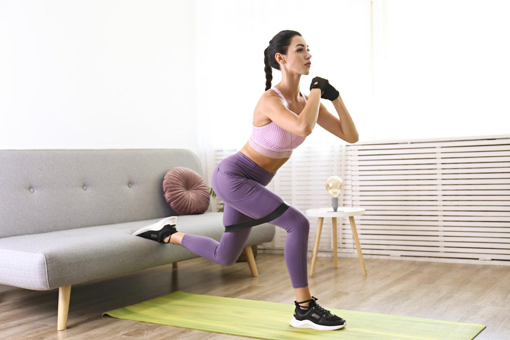 Full body workout at home: Woman doing Bulgarian split squats