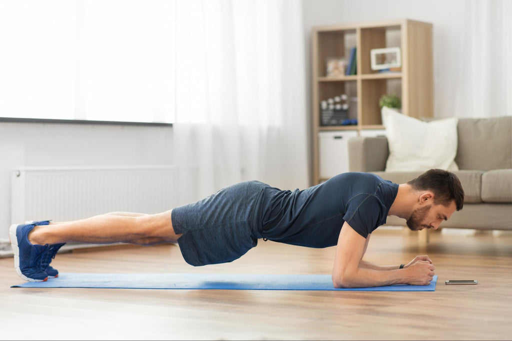 Man doing plank exercise at home