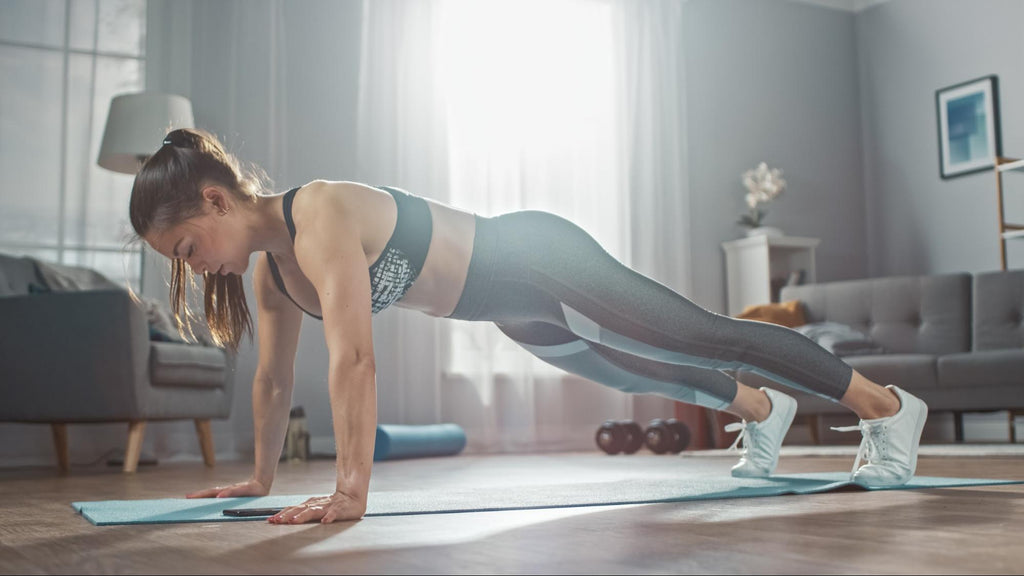 Full body workout at home: Woman doing push-ups