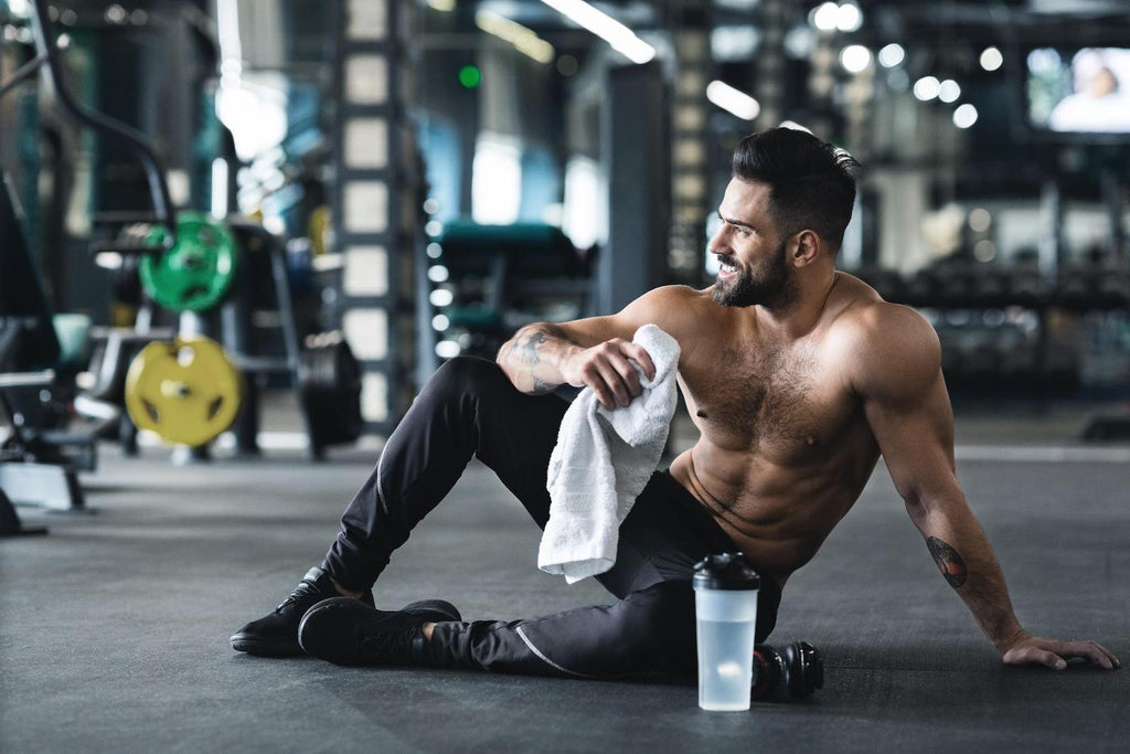 How to get stronger: Muscular man resting after workout