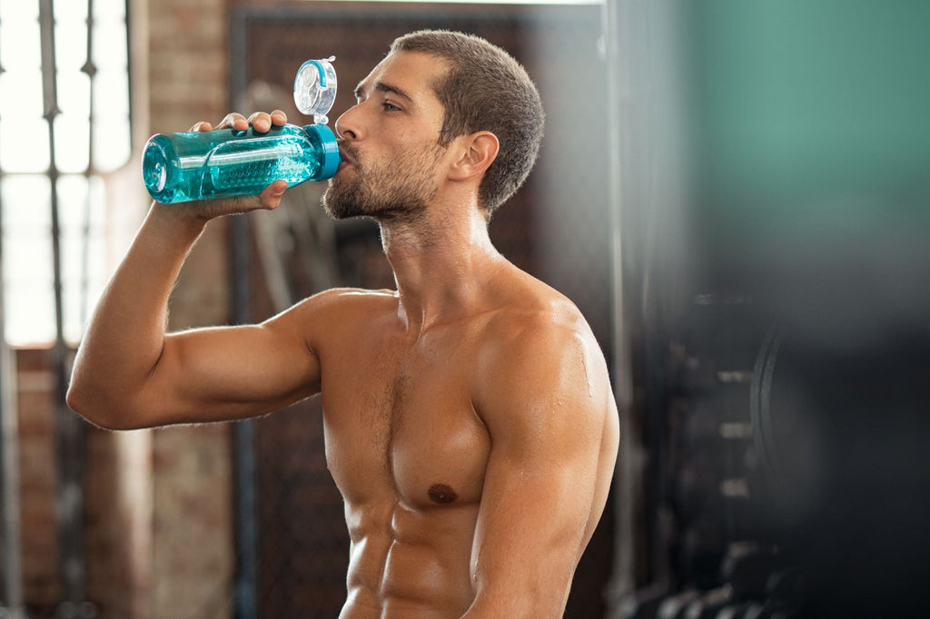 Muscle recovery: Man drinking post-workout shake