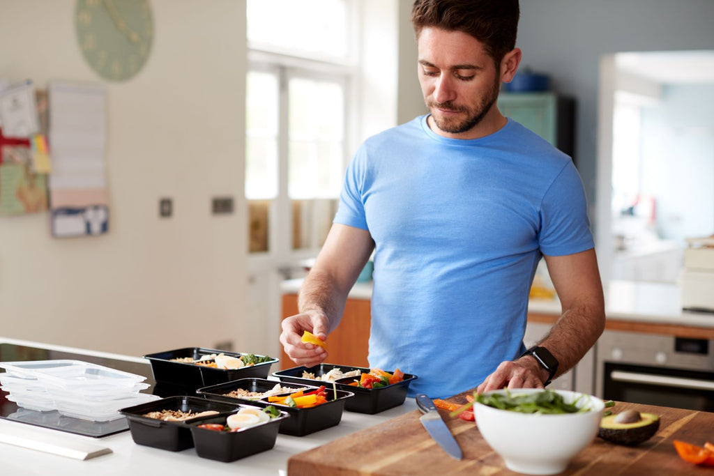 Man meal-prepping with healthy foods