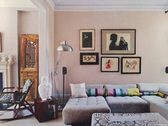 Family room with a collection of paintings on the wall