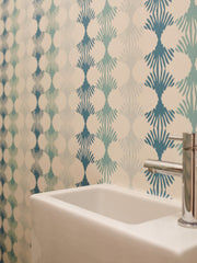 Lotus blue and green wallpaper by Jam Space used in the guest bathroom