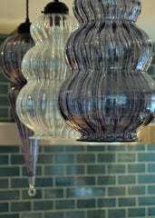 Handmade colourful glass lights above the kitchen counter