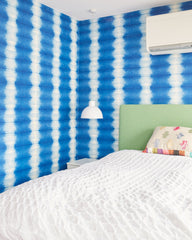 Youngest daughter's bedroom with magnetic blue wallpaper