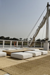 Rustic seating area under the sails