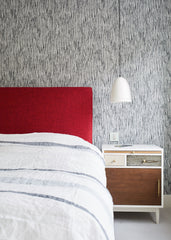 Teenager's bedroom, neutral colours with a splash of red