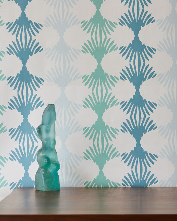Image of Lotus Blue and Green wallpaper, with a glass paste statue in front of it