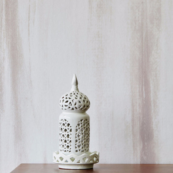 Mahara wallpaper with a white ceramic lantern on top of wooden table