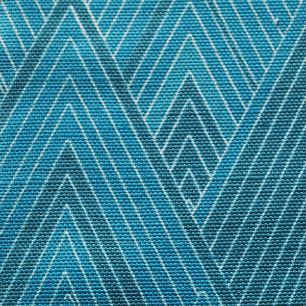 Close up of Edfu Pyramids Kingfisher fabric