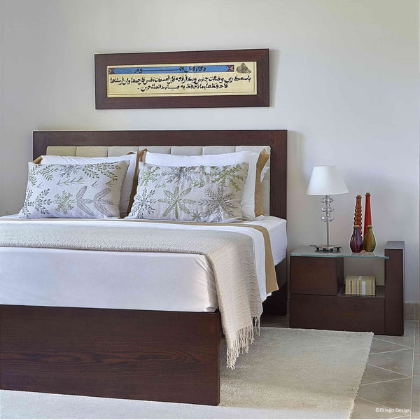 Lifestyle image of the Modern Eclectic bedroom, showing the bed and its headboard and the bedside table.