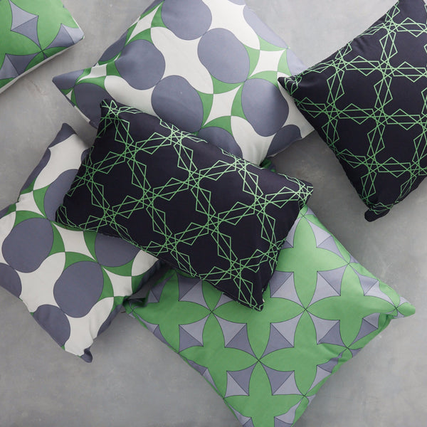 Pile of cushions, covers made with Tulun Green, Nocturn Green and Stars Black&Green