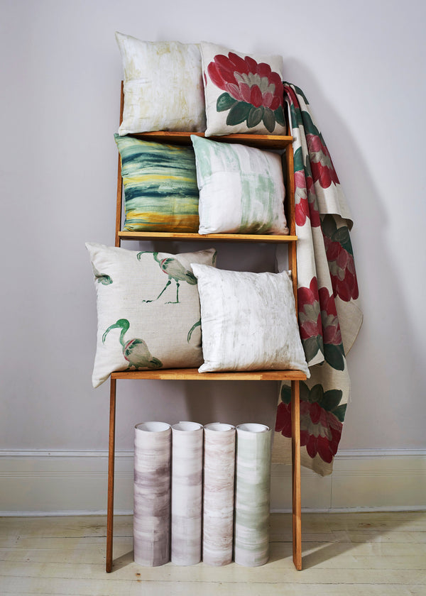 Safari Warda cushion and fabric on shelves with other safari cushions