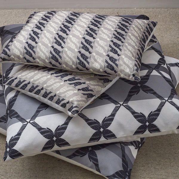 Large pillows in Edfu Wings Charcoal fabric and Edfu Falcon Taupe fabric
