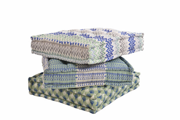 Floor cushions made with Siwa Aqua fabric and other fabrics from the Ornamental Stories collection