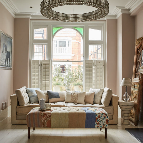 Lifestyle shot with Lotus sofa, patchwork bench, crystal Roundmond chandelier and Tabla sidetable