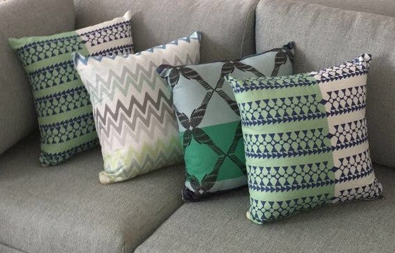 throw pillows made with Edfu Wings Aqua fabric as well as a variety of other Ornamental Stories fabrics