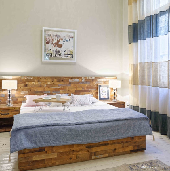 Lifestyle image of the Bohemian comfort bedroom, showing the Reclaimed headboard, bed and bedside tables.