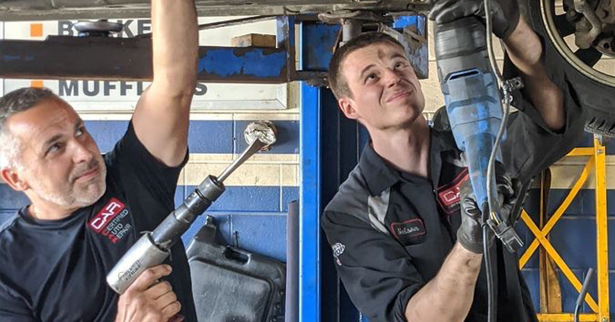 Auto mechanics at Nelson's Certified Auto Repair in Ontario, Canada wear UniFirst uniforms