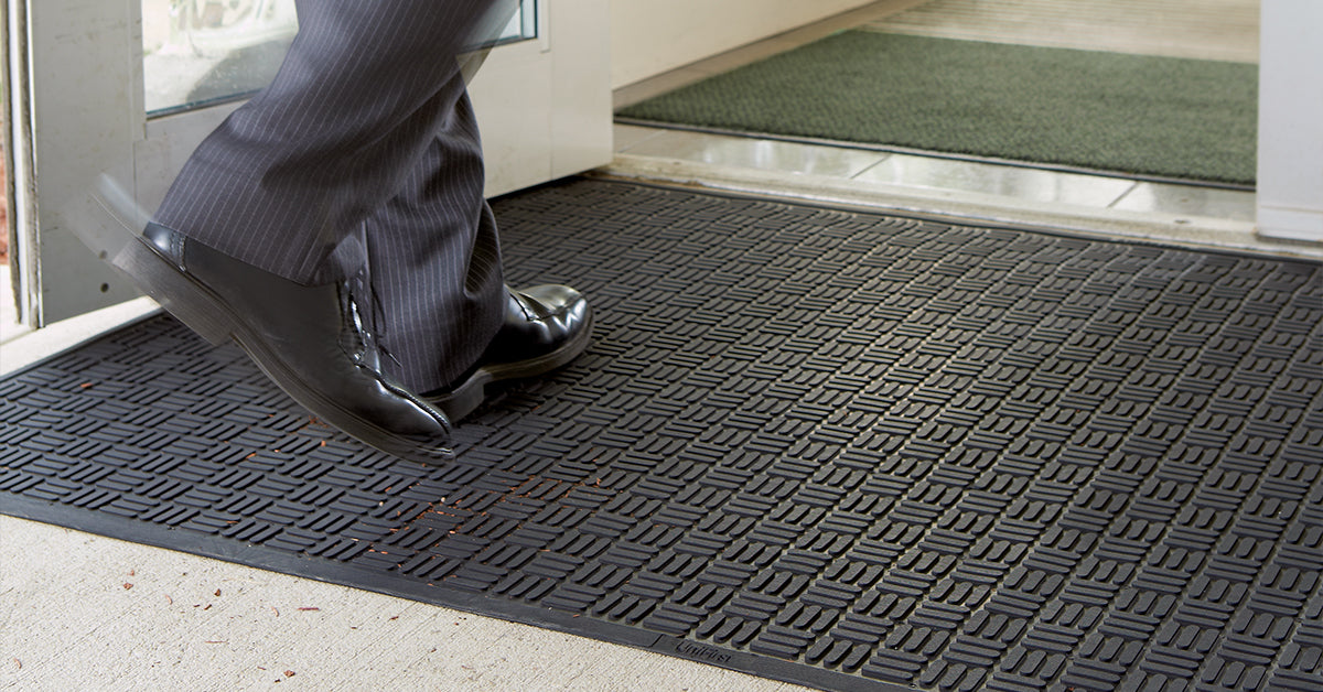UniScraper rubber scraper mats from UniFirst outside the entrance of a business