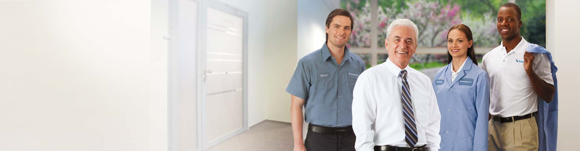 Customized and branded uniforms and workwear on four employees