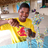 Khutsala artisan at Heart for Africa in Swaziland making beaded animals