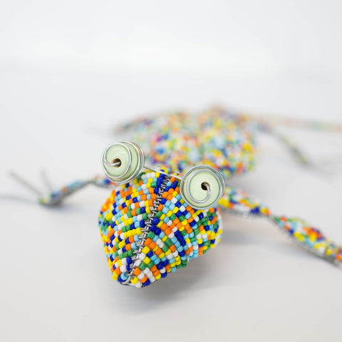 Multi-colored wire and glass bead lizard made by the Khutsala artisans at Heart for Africa in Swaziland