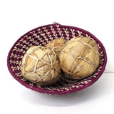 Banana leaf soccer balls in a basket