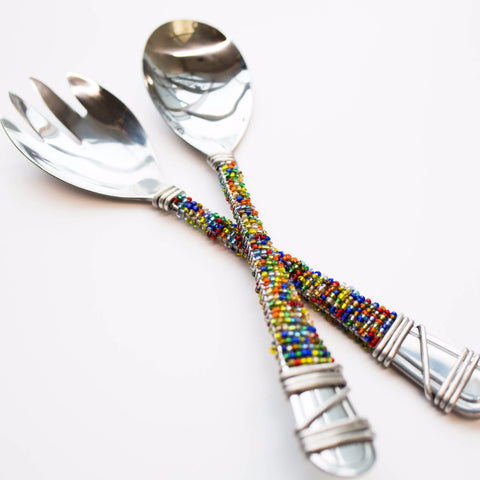 Multi-colored beaded serving spoon and fork set made by the Khutsala artisans at Heart for Africa in Swaziland