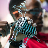 Khutsala artisans at Heart for Africa in Swaziland making beaded animals