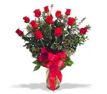 A dozen red roses in vase