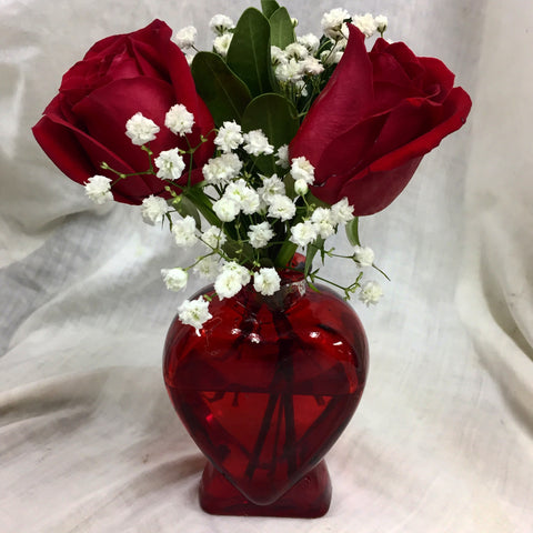 Red rose in heart vase