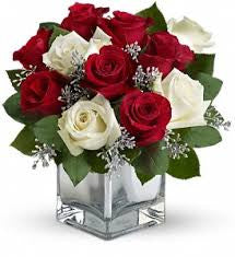 red and white roses in block vase
