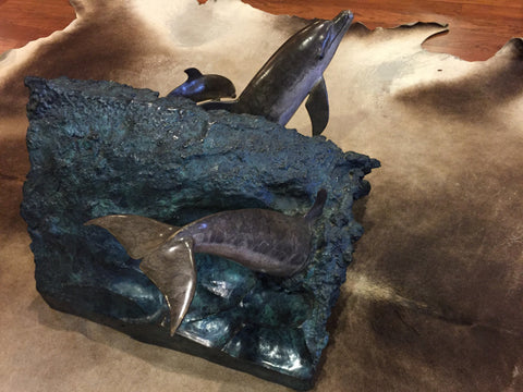 "Robert Wyland (American, b. 1956), ""Dolphin Experience"" End Table, 1992, polychrome bronze with glass top, signed, ed. 450"