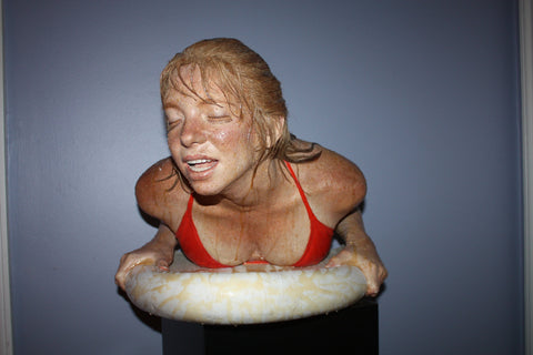 "Carole A. Feuerman (American, b. 1945), ""Surfer"", 1984, cast resin and oil, signed, ed. 8"