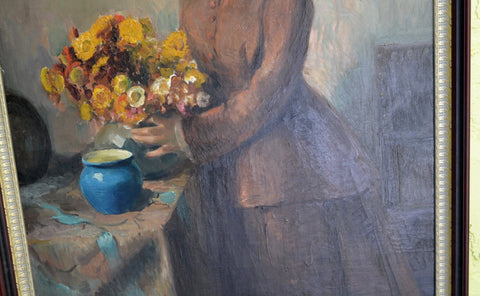 Andre Brunin (French, b. 1890), Lady Arranging Flowers, oil on canvas, signed