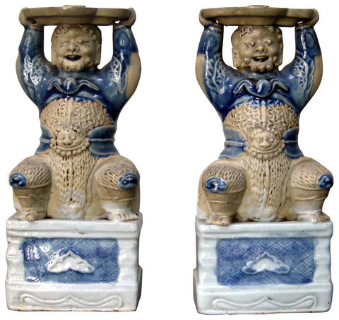 Pair of Blue and White Glazed Biscuit Figural Joss Stick Holders, China, Qianlong period (1736-1796)